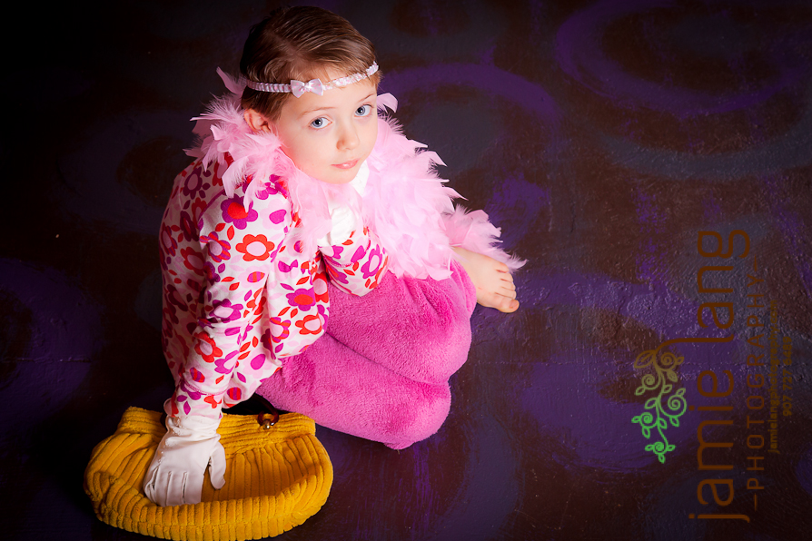 studio session with a 7 year old wearing a boa; family photography anchorage alaska;