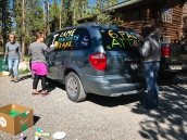 Adding our names to Becky's van