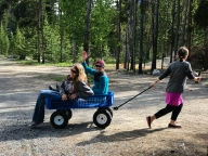 Val pulling Becky and Monica in the wagon